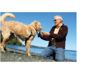 Metchosin resident Gerry Fletcher, seen here with his dog Ginger, continues to work on alternative energy at Race Rocks. The CRD bestowed Fletcher a lifetime environmental achievement award.